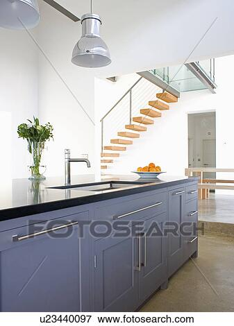 Island Unit With Grey Fitted Cupboards In Modern Open Plan Kitchen