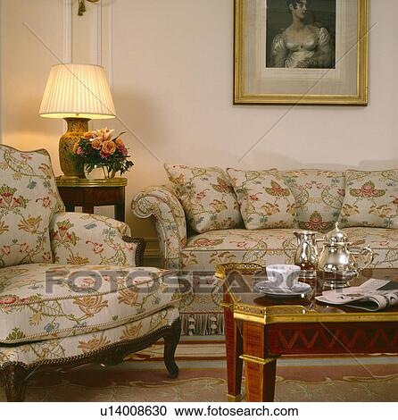 Phenomenal Lighted Lamp On Small Table Between Floral Patterned Sofa Pdpeps Interior Chair Design Pdpepsorg
