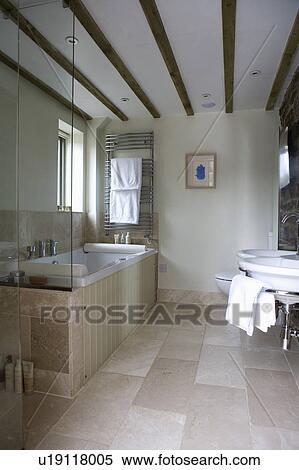 Limestone Floor Tiles In Modern Country Bathroom With Beamed Ceiling