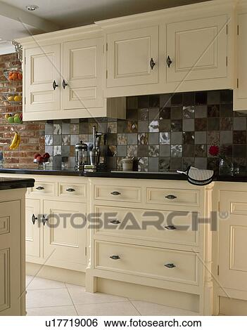 Metallic Wall Tiles In Kitchen With White Fitted Cupboards And Units