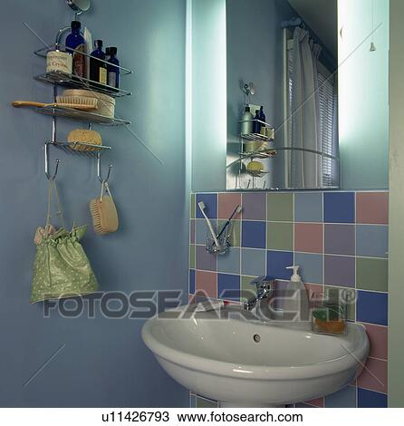 Stock Photo Of Mirror And Pastel Tiles Above Basin In Pale Turquoise