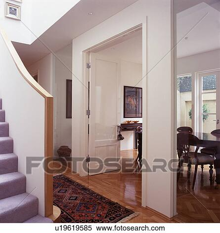 Open Double Doors To Dining Room In Openplan Modern White Hall