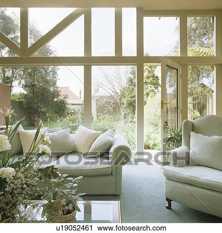 Pastel Blue Sofas In Modern Conservatory Living Room
