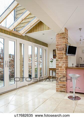 Stock Image Of Patio Doors And Limestone Flooring In Modern Kitchen