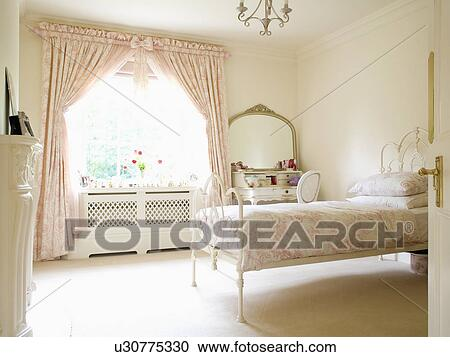 Pink Toile De Jouy Curtains And Bedlinen In Cream Country Bedroom With Carpet Wrought Iron Bed