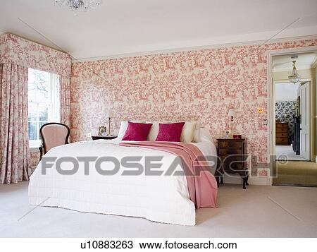 Pink Toile De Jouy Wallpaper And Curtains In Country Bedroom With Cream  Quilt And Pink Throw On Bed