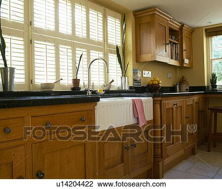 Plantation Shutters On Window Above