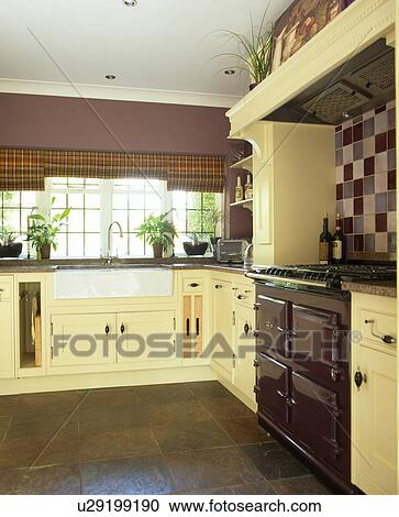 Stock Photography Quarry Tiled Floor In Purple Kitchen With Cream Ed Units And