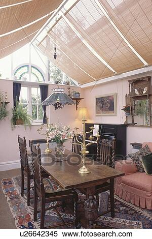 Split Cane Blinds In Conservatory Extension Dining Room With Oak Table And Chairs Stock Photography U26642345 Fotosearch