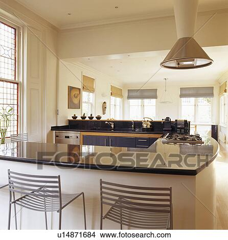 Stools At Breakfast Bar In Modern Open Plan Kitchen And Living Room Picture U14871684 Fotosearch