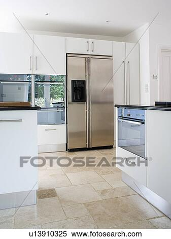 Travertine Floor Tiles In Modern White Kitchen With Large