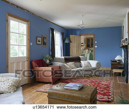 country living room rugs stock photography of striped sofas and chest in blue 16458
