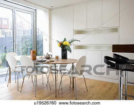 Stock Photography   White Arne Jacobsen U0027Antu0027 Chairs At Pale Wood Table In  Modern