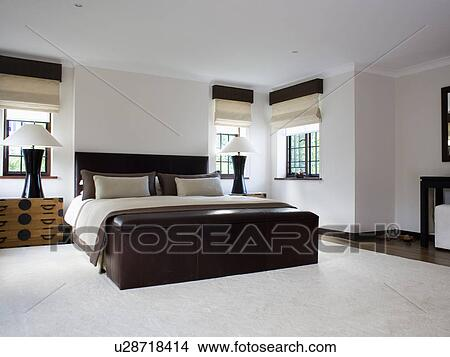 Picture White Carpet And Large Leather Chest In Modern Bedroom With Cream Brown