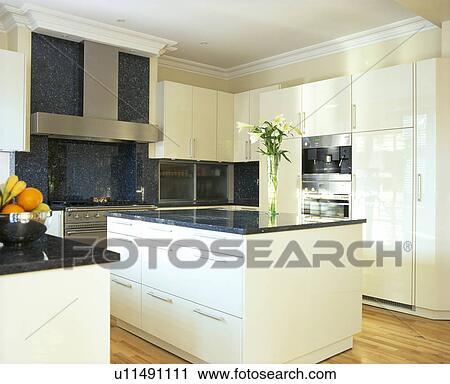 stock photography of white island unit with black granite worktop in