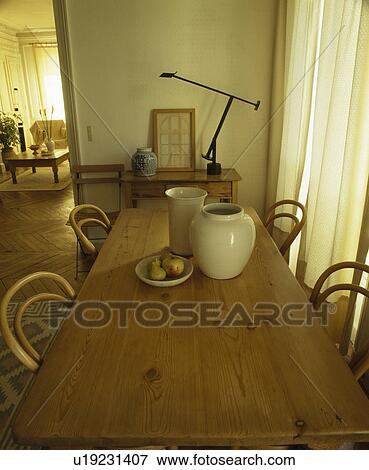 Stock Photo   Bentwood Chairs And Antique Pine Table In Traditional French  Dining Room. Fotosearch
