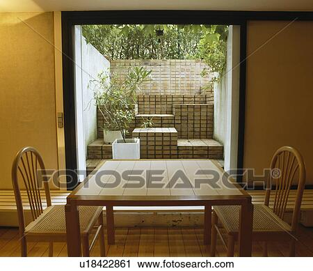 Pale Wood Table And Chairs In Front Of Large Window In Small Modern Dining  Room