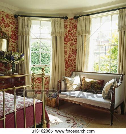 Red Toile De Jouy Wallpaper In Bedroom With Antique Sofa In Front Of Window