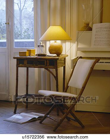 Small Cream Folding Chair And Antique Table In French Living Room