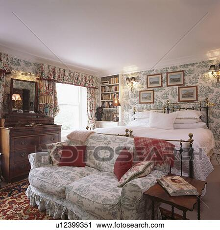 Stock Photography   Toile De Jouy Sofa In Comfortable Bedroom With Wallpaper  And Pictures