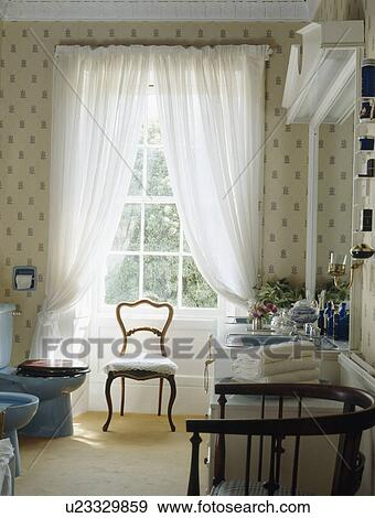 White Voile Curtains On Window In