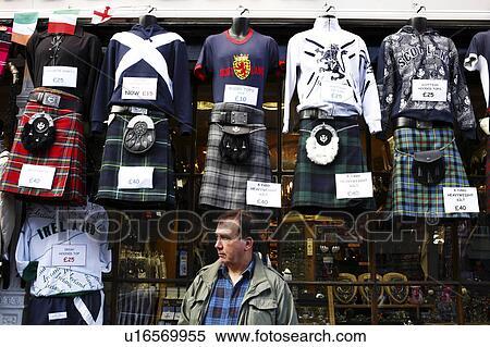 Scotland, City of Edinburgh, Edinburgh  Tartan kilts and Scottish tops  hanging outside a shop on The Royal Mile  Stock Photography