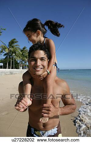 View of young man carrying a small girl  Stock Image