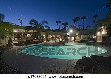 Mansion with pool at night  Stock Photography of Swimming pool in front of modern mansion at ...