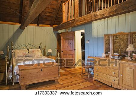 Brass Bed And Furnishings In The Master Bedroom On The Upstairs Floor Of An Old Canadiana 1722 Cottage Style Fieldstone And Wooden Siding Residential Home Quebec Canada Stock Photo U17303337 Fotosearch