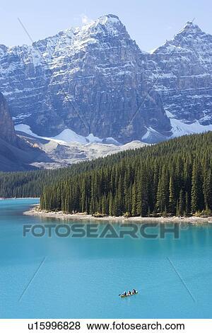 People Canoeing On Moraine Lake Alberta Banff National