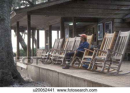 Marvelous Cumberland Island Georgia Woman Sitting On Rocking Chair Gmtry Best Dining Table And Chair Ideas Images Gmtryco