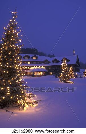stock photography of lodge resort inn trapp family lodge christmas x mas xmas winter trees vermont the snow covered trapp family lodge is - The Christmas Lodge