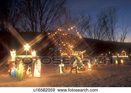 Stock photograph of christmas postcard decorations nativity scene christmas postcard decorations nativity scene christmas holiday outdoor snow winter a nativity scene and lights decorate a home at night in richmond aloadofball Image collections