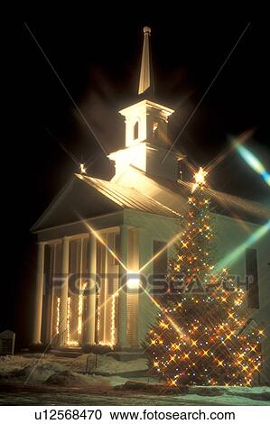 stock photography of church christmas tree decorations holiday snow outdoor winter tiny colorful lights decorate the evergreen tree outside the