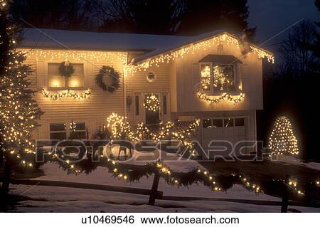house home christmas decorations lights snow winter a house is elegantly trimmed with tiny white lights for the christmas holiday season in