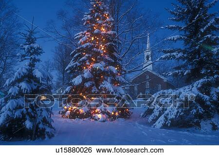 village christmas tree church decoration holiday outdoor snow winter scene vermont a large snow covered christmas tree is decorated with tiny