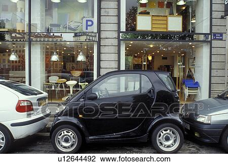 stock photo of swatch car lyon france rhone alpes europe swatch car parallel parked in a. Black Bedroom Furniture Sets. Home Design Ideas