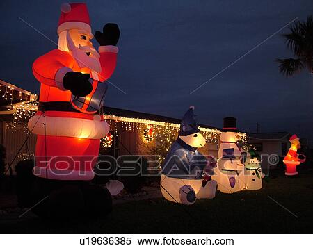 daytona beach fl florida residence home christmas decorations large inflatable santa claus snowmen polar bear and simpsons characters night - Polar Bear Inflatable Christmas Decorations