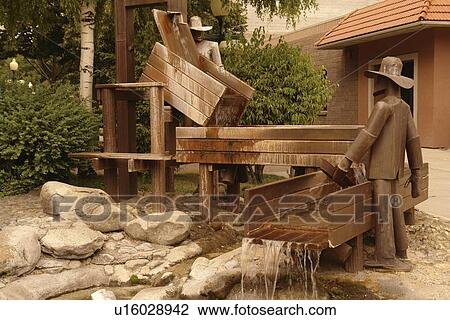 Helena, MT, Montana, downtown, gold mining statue, fountain, Last Chance  Mall Stock Image