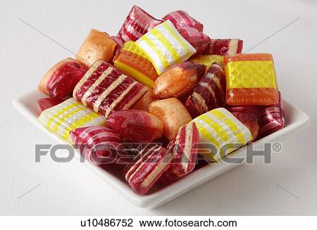 assorted square traditional american christmas candy on white