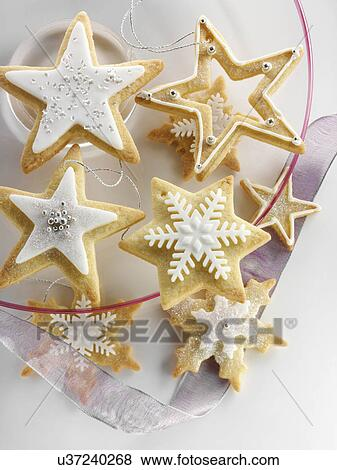 Star Shaped Iced Christmas Biscuits Stock Photo