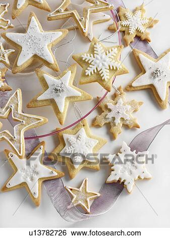 Star Shaped Iced Christmas Biscuits Stock Photograph