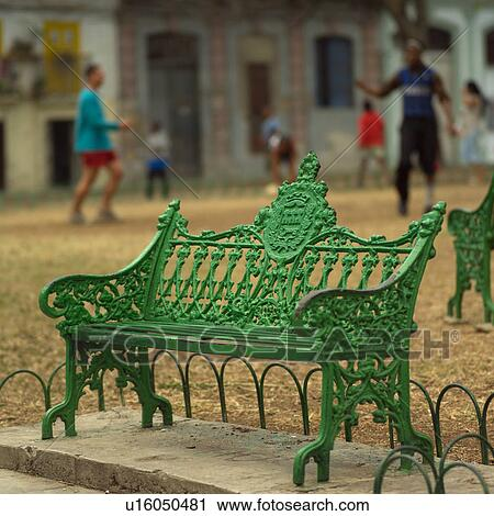 Stock Photography Of A Park Bench With People In The Background