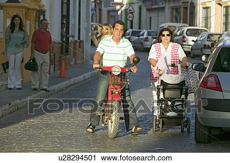 Man On Motorcycle And Woman With Baby In Village In Southern Spain Off Highway A49 West Of Sevilla Stock Image U28294501 Fotosearch