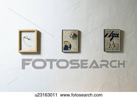 Stock Photography of Three artistic frames hung on wall u23163011 ...