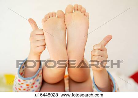 pictures of girl showing soles of her feet and hands with thumbs up