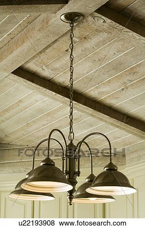 Light Fixture Hanging From Wood Beam