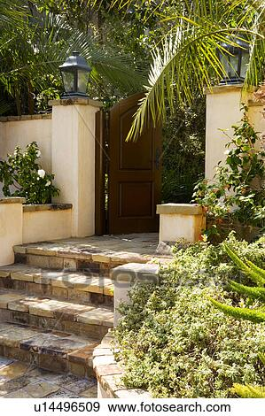Stock Photograph Of Front Gate And Steps To Spanish Style Home