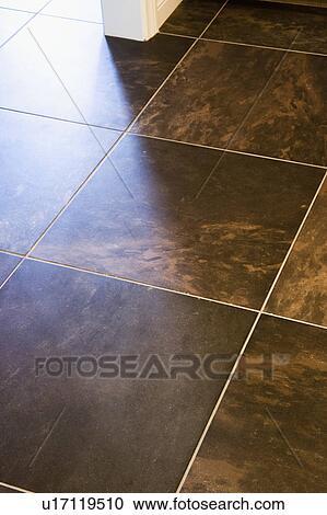 Dark Brown Tile Flooring Stock Image