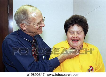 Woman with a disability undergoing a routine physical check-up/medical exam  with a physician  Stock Photo